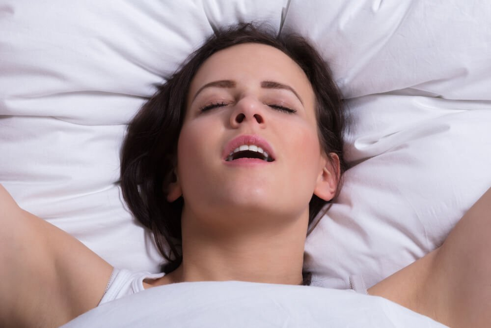 Woman In Bed Getting Orgasm