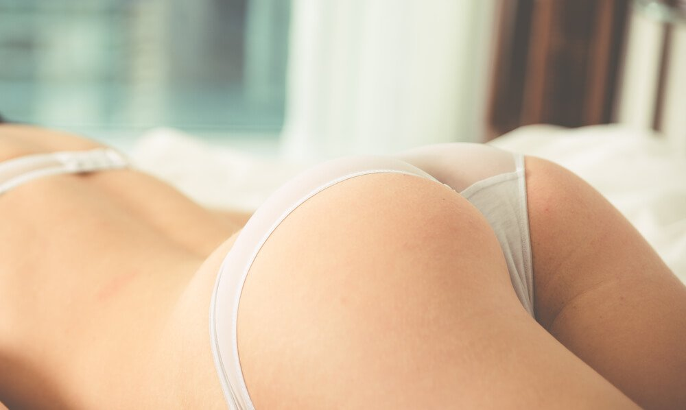 Woman buttock view while lying down in bed