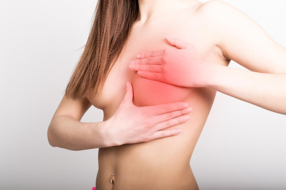 woman feel breast pain