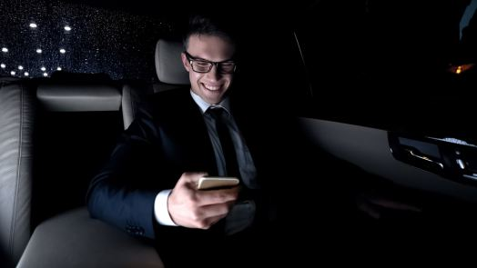 Male in suit texting with girlfriend