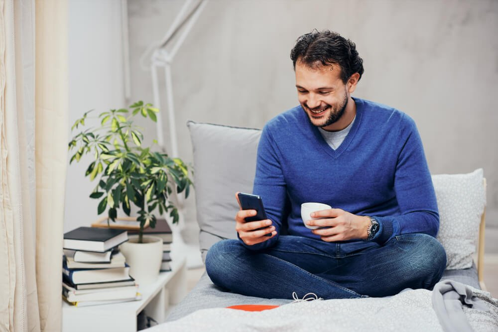 man using smart phone for texting